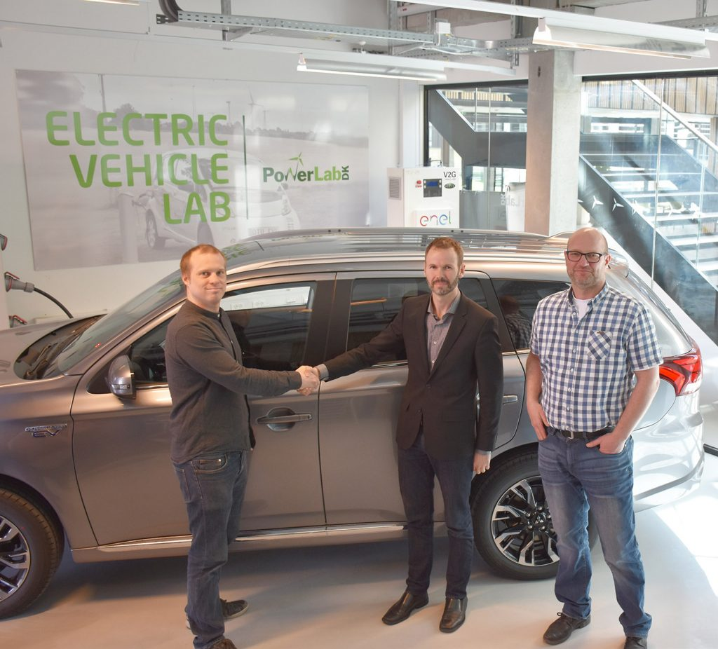 Tobias Gerster, Brand Manager, Mitsubishi Denmark (center) with Peter Bach Andersen, Senior Researcher at DTU Electrical Engineering (left) and Project Manager of Parker Thomas Sørensen, Development officer at DTU Electrical Engineering (right)